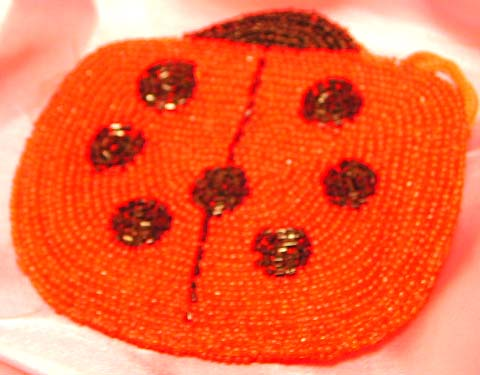 Fashion beaded bag of lady bug pattern design, a latest fashion and design wholesale manufacture. An eyes-catching piece you can't never seen!