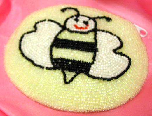 Light yellowish rounded fashion beaded purse with happy bee pattern design